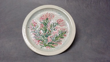 Downy Paintbrush, carved stoneware charger, 9 in dia $75