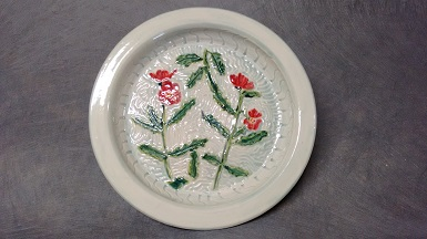 Globe Mallow, carved stoneware 9 in dia, $75