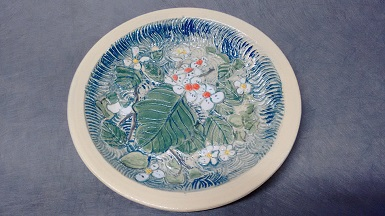 Hawthorn charger, carved stoneware, 9 in dia, $75